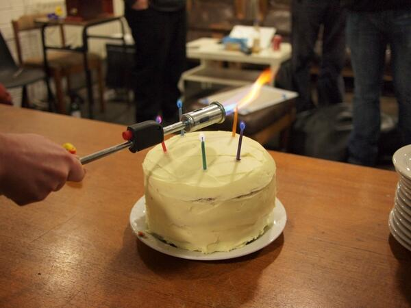 Cake lit by blowtorch