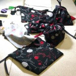 The drawstring bags made by the workshop attendees